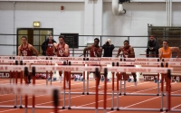 The men's track and field team hurdles in IU's dual meet against Tennessee in January in Harry Gladstein Fieldhouse. Senior hurdler Adrian Mable (second from right) and freshman sprinter William Sessions (third from right) finished first and second in the event.