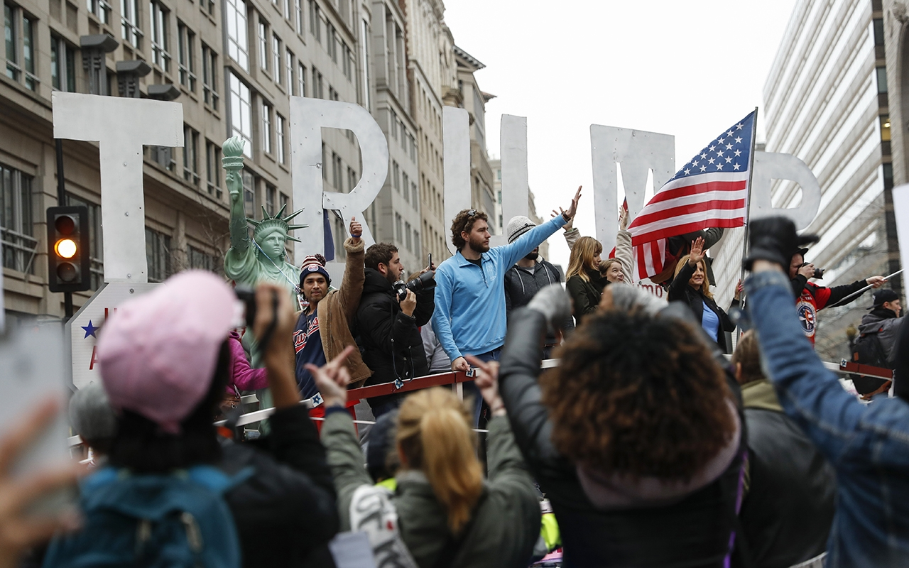 Trump supporters wave from a float at the Women's March on Washington protesters Jan. 21 in Washington, D.C.
