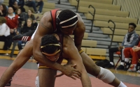 Senior Nate Jackson takes down Minnesota's Robert Stevenson in January in University Gym. Jackson placed eighth at the NCAA Championships and grabbed his second All-America honor this weekend.