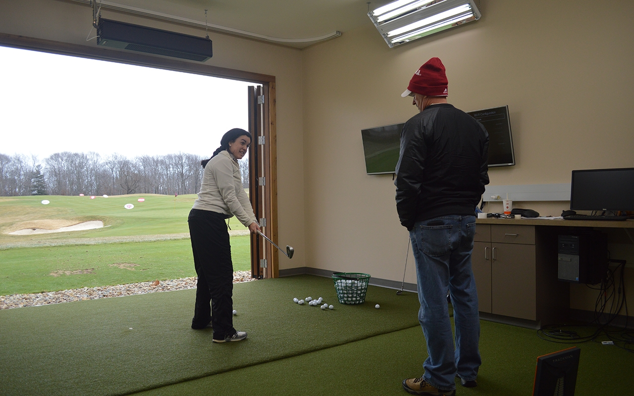 Senior Ana Sanjuan worked on her swing with IU Coach Clint Wallman during an individual training session in early February. Sanjuan and the Hoosiers are traveling to Arizona this weekend for their first tournament of the season.