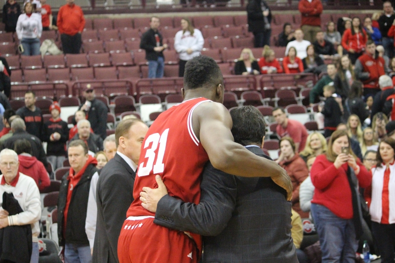 Sophomore center Thomas Bryant and IU Coach Tom Crean walk off the court together after the victory against Ohio State. Bryant, along with junior guard James Blackmon Jr., were named third team all-Big Ten on Monday.