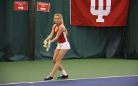 Sophomore Madison Appel serves the ball during the women's tennis doubles match against West Virginia on March 4. On Thursday, Appel was named to the women's tennis All-Big Ten team.