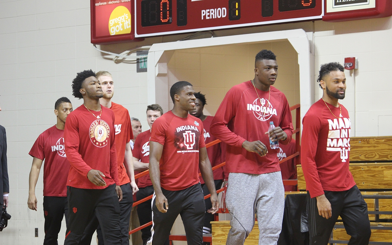 IU men's basketball players walk onto the court to watch new head coach Archie Miller speak to the public for the first time at his introductory press conference on Monday, March 27.