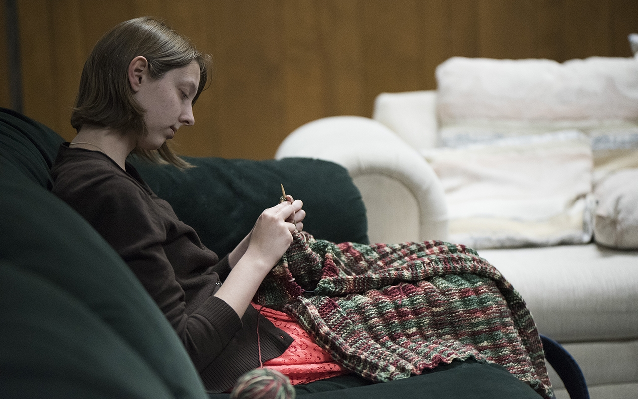 Angela Harris, a graduate student studying Japanese, knits a colorful shawl Monday night. Four women gathered in the basement of St.Paul's Catholic Center to knit shawls for charities and sick parishoners.