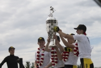 Black Key Bulls riders hold up the trophy Saturday afternoon after winning the 67th running of the men's Little 500 race.