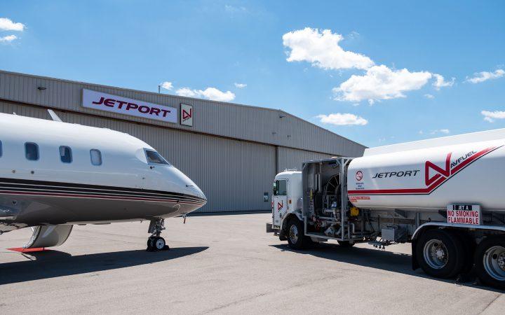 Truck and private jet outside Jetport hanger.