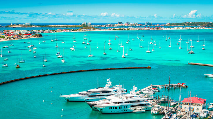 View of ships and boats in water in St. Maarten