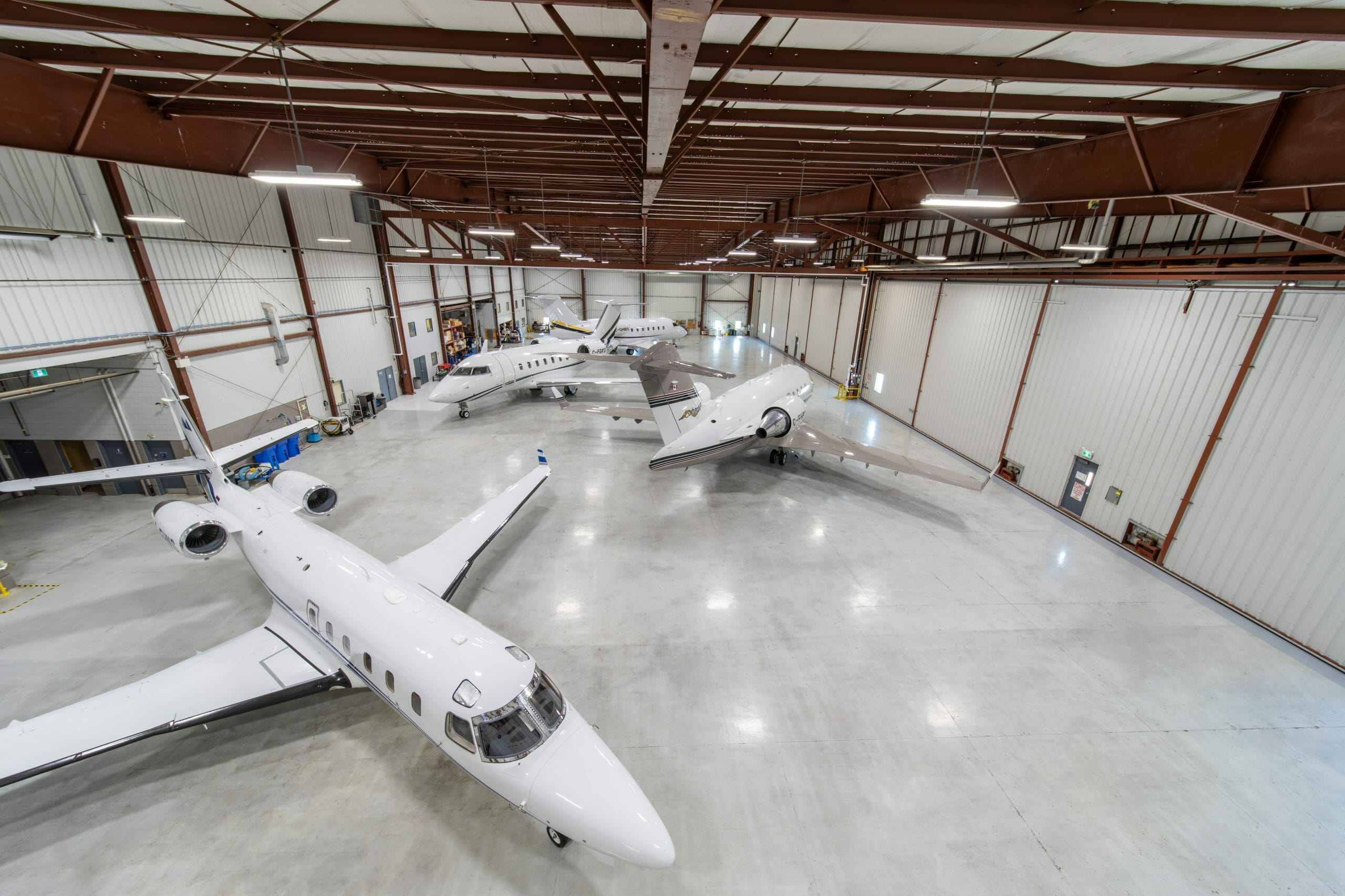 Overhead view of 4 jets in a hanger.