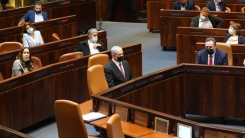 Prime Minister Benjamin Netanyahu sits alone in the Knesset for the Monday night vote (Photo The Knesset)