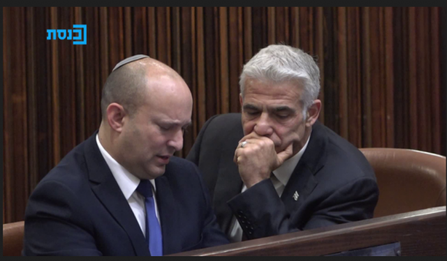Yamina head Naftali Bennett and Yesh Atid leader Yair Lapid, who are trying to form a government to replace Benjamin Netanyahu, at the Knesset vote for president on Wednesday (Photo: The Knesset Channel)