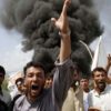 Afghanistan - Taliban Civilians crowd at the site of an explosion in Afghanistan