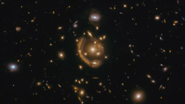 """the largest and one of the most complete Einstein rings ever discovered, dubbed the """"Molten Ring"""""""