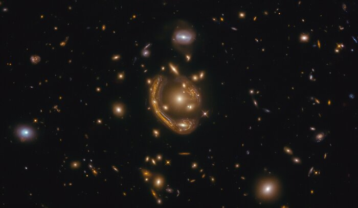 In this image, the narrow galaxy gracefully curling around its spherical companion is an incredible illustration of a genuinely odd and extremely rare event.