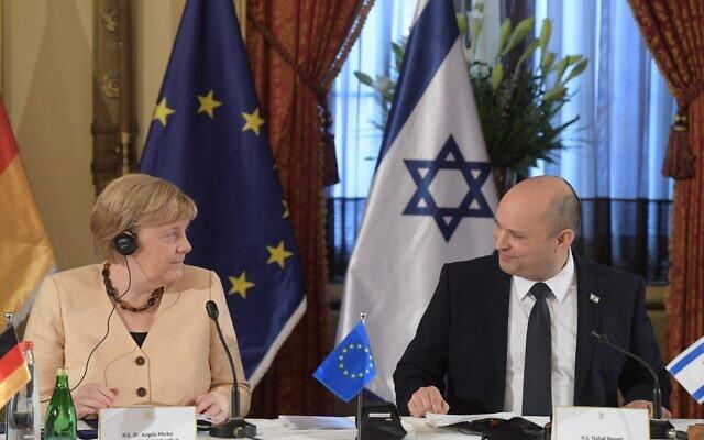 Bennett-Merkel-cabinet--Prime Minister Naftali Bennett welcomes German Chancellor Angela Merkel during a special cabinet meeting in Jerusalem, October 10, 2021 (Amos Ben Gershom GPO) 640x400