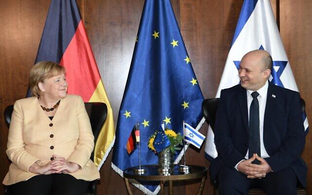 Prime Minister Naftali Bennett (R) meets with German Chancellor Angela Merkel at the King David Hotel in Jerusalem, October 10, 2021 ((Amos Ben Gershom, GPO)