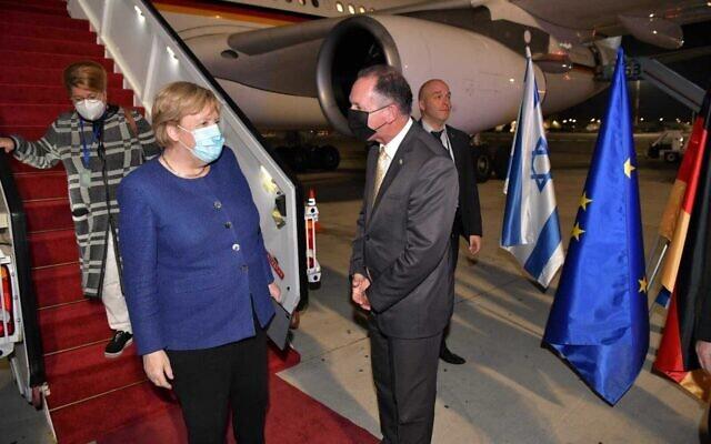 German Chancellor Angela Merkel arrives at Ben Gurion Airporty on her farewell visit to Israel, on October 9, 2021. (Shlomi AmsalemForeign Ministry)