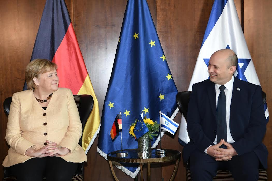 Naftali Bennett in Meeting with Chancellor of Germany Angela Merkel Oct 2021 credit Amos Ben-Gershom (GPO)