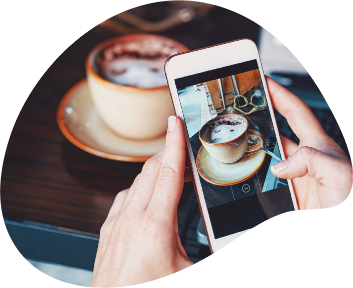 Food and beverage PR agency capturing image on mobile device