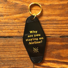Why Are You Staying On Airline? Motel Keychain by Dirty Coast