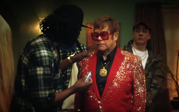 Elton John Takes On Rappers For Snickers 08/31/2018
