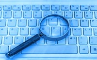 Laptop-with-a-magnifying-glass