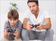 Father-son-playing-video-games-Shutterstock-B