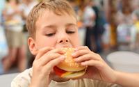 Boy-eating-burger-Shutterstock-A