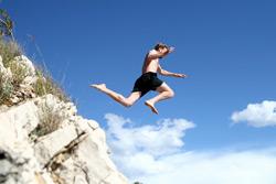 Man-jumps-off-Cliff-Shutterstock-B