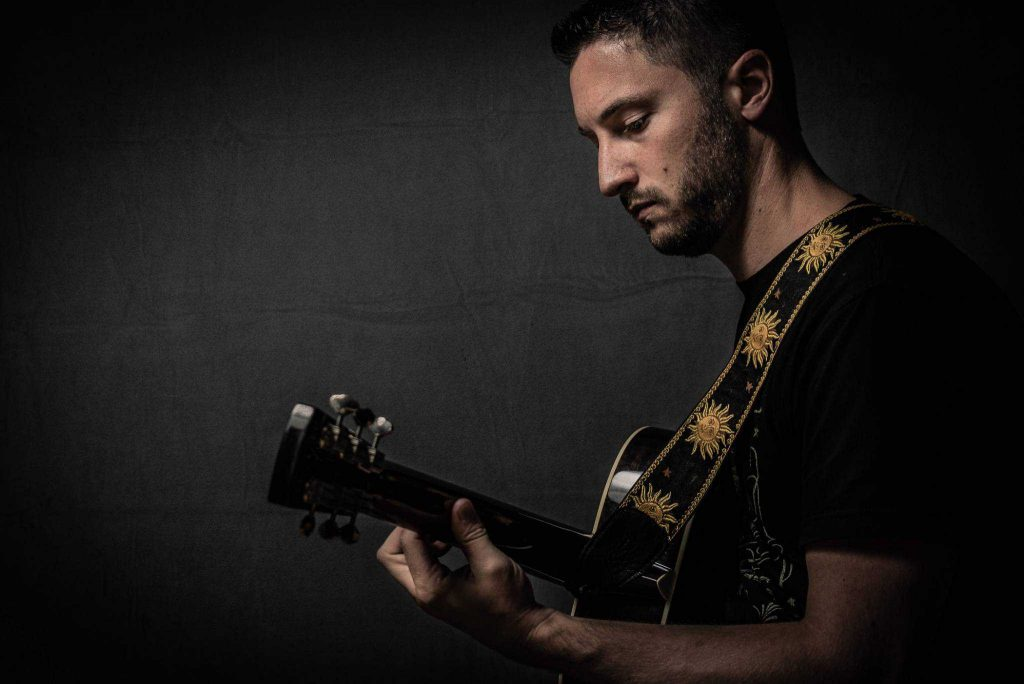 Blake Titus with guitar