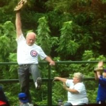 65-year old Chicago Cubs fan catching home run violates many fan codes for manly ballpark behavio...