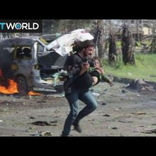The War in Syria: Syrian photographer rescues blast victim