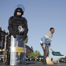 Baltimore Sweeps Up Ashes After Night of Looting, Arson, and Violence