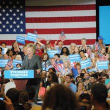 Clinton stirs crowd, lays out economic policy at state fairgrounds