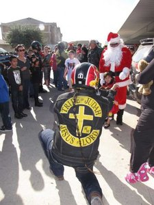 Motorcycle crash doesn't hinder group's toy drive