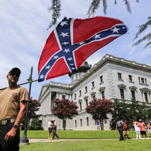 KKK met with skirmishes at rally to protest Confederate flag removal