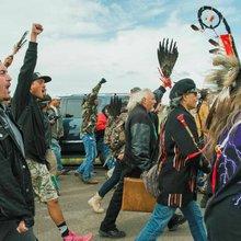 After protests, U.S. halts North Dakota pipeline near tribal lands