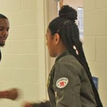 This N.C. teacher has a personalized handshake for every one of his students
