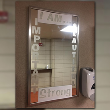 Teachers engrave messages on mirrors to inspire students