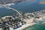 Where no dunes were built, an unmeasurable cost