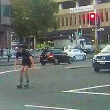 Sydney's craziest rollerblader caught on camera speeding through CBD peak-hour traffic at 50km/h