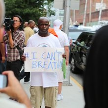 Why Did Police Arrest This Man In Front of His Kids at Eric Garner's Funeral? | VICE | United Sta...