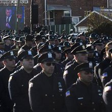 Amid tension, more than 20,000 attend NYPD funeral