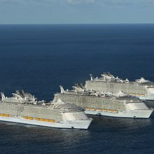 Video: A big day for the world's largest cruise ships - Harmony of the Seas meets sisters Oasis a...
