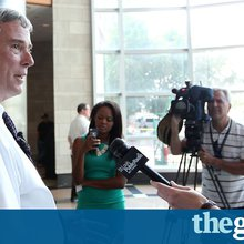 Cloud over Michael Brown inquiry as attorney general arrives in Ferguson