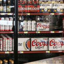 A potent brew: Money, muscle and back-slapping protect liquor store grip on cold beer