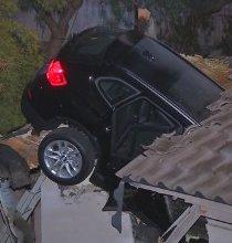 Car crashes into garage -- through the roof - CNN.com