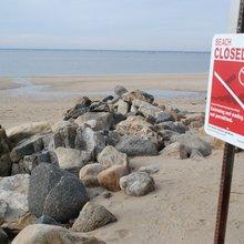 Sewage source still a mystery at Glen Cove beach