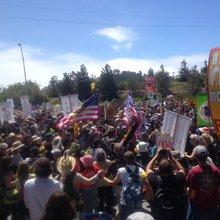 Thousands march to Chevron days before fire anniversary