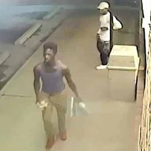 Surveillance photos of suspects in 7-Eleven robbery, shooting