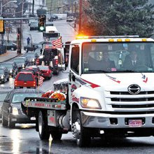 Lowell man's funeral had many friends in tow